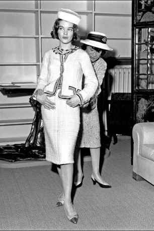 coco-chanel-in-her-atelier-fitting-actress-romy-schneider-in-the-1960s